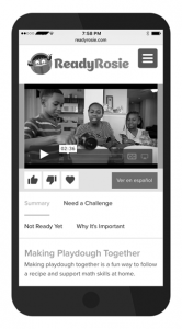 Ready Rosie is a parent child learning together tool that sends texts to your cell phone. This image shows a cell phone with a Ready Rosie message that has a 2 minute video about making playdough together.