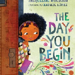 """""""The Day You Begin"""", by Jacqueline Woodson. Image of a brown skinned childe with dark curly hair coming through a doorway with a purple book. Colorful, decorative designs erupt from the book and surround the book title."""